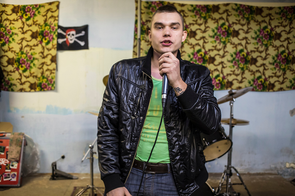 Zhenia Nabirkin, 26, performs a rap he wrote while rehearsing in the basement of a local school on Tuesday, November 12, 2013 in Asbest, Russia.