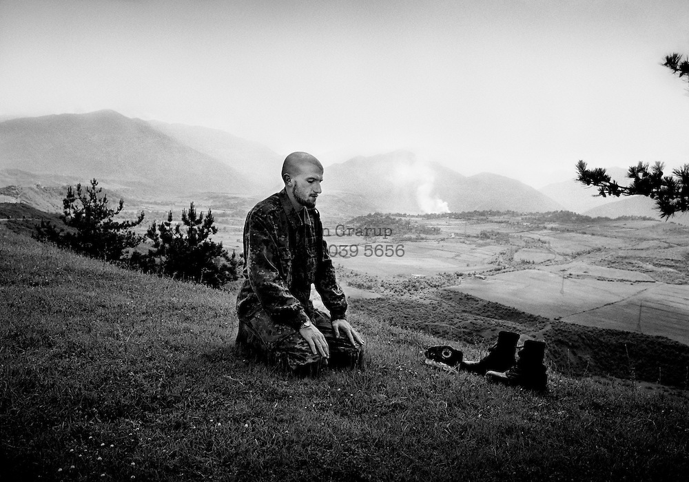 Kasem Muhamedi was imam of his home village of Prizren in Kosovo, but was forced to flee when the Serbian military expelled ethnic Albanians from the town. Now he is back in Kosovo as an armed UCK partisan.  Spring 1999.