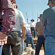 An auctioneer sells tools at a farm auction in eastern Colorado
