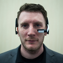 London, UK - 17 March 2014:  a man wears Kopin 103 smart glasses at the Wearable Technology Conference at Olympia in London