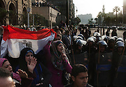 Egyptian protesters wave a national flag and chant anti-government slogans during continuing January 26, 2011 demonstrations in downtown Cairo, Egypt. A series of unprecedented demonstrations have broken out across Egypt for the past two days, inspired by the revolution in Tunisia, and intended to spark a similar movement in Egypt.(Photo by Scott Nelson)