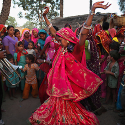 Family members and guests dance before the wedding of three young sisters to three young brothers in Rajasthan, India on April 26, 2009.  The sisters range in age from five to 22-years-old.
