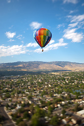 """Ballon Over Reno 5"" - This hot air balloon was photographed from a balloon during the 2011 Great Reno Balloon Race. The ""toy"" like effect was achieved using a tilt-shift lens."