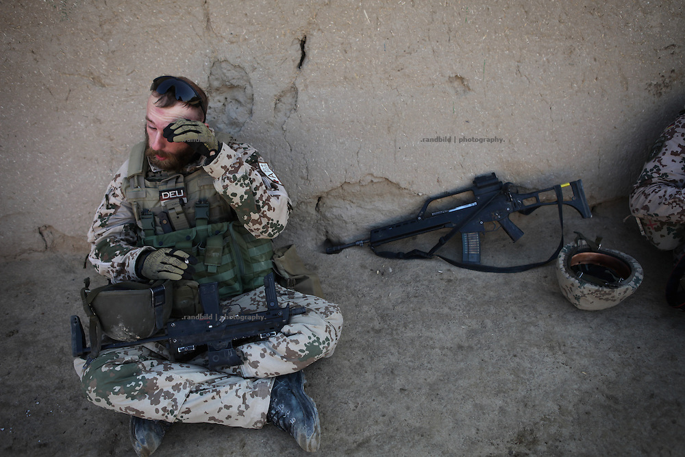 A private wipes his forehead during a break at the roadside. In late October 2011 Kunduz based 3.Task Force started a several days operation in and around Nawabad (District Chahar Darah), west of Kunduz, northern Afghanistan. During the Operation Orpheus about 100 german infantery soldiers rolled out for patrols through the town and surrounding areas, which were expected as a retreat zone of insurgents.