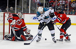 February 20, 2008; Newark, NJ, USA;  New Jersey Devils defenseman Andy Greene (6) defends against San Jose Sharks center Torrey Mitchell (17) after a save by New Jersey Devils goalie Martin Brodeur (30) during the first period at the Prudential Center in Newark, NJ.