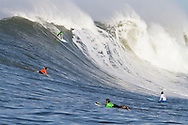 """Grant """"Twiggy"""" Baker drops into a giant wave during the first heat of the Mavericks surf contest Saturday, Feb. 13, 2010, in Half Moon Bay, California"""