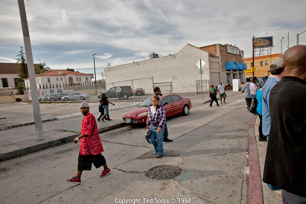 The area where a woman pushing a stroller with her daughter on Vermont Ave and 83rd n South Central Los Angeles 20 years later.