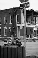 """The center of Elmwood, IL has always been """"the four way stop"""", at Main and Magnolia Streets. It is the center of the town's business district, and the only major intersection in town. After the town was hit with a destructive tornado on the night of June 5th, 2010, this is what was left of the street sign at the main intersection, with much damage inflicted to the surrounding historic buildings in the downtown business district."""