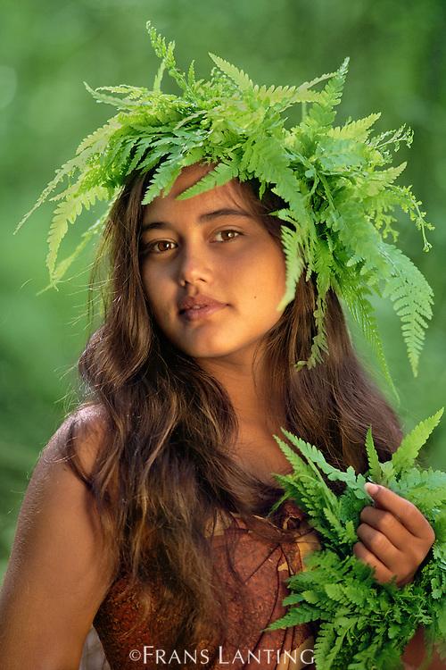 Hawaiian girl with fern, Kauai, Hawaii