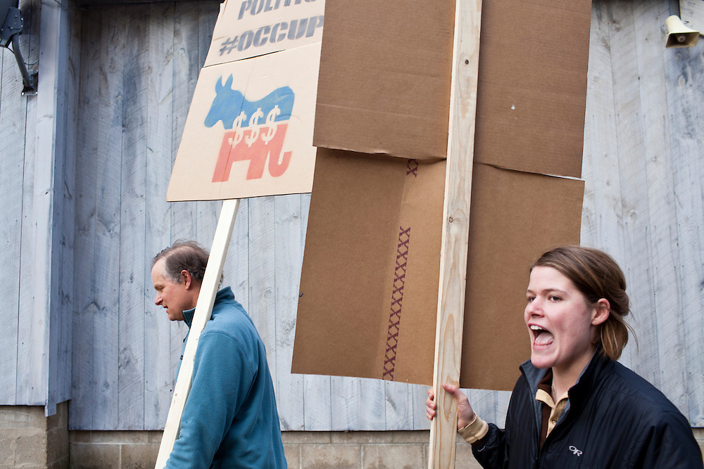 William Peery, left, and Cecile Reuge hold an Occupy movement protest after Republican presidential candidate Rick Santorum hosted a meet and greet at Homestead Grocery and Deli on Saturday, January 7, 2012 in Amherst, NH. Brendan Hoffman for the New York Times