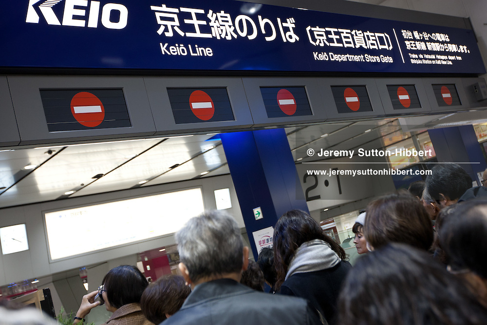 Tokyo people flood stuck in Shinjuku trains station, as trains are cancelled, moments after an earthquake that hit northern Japan but which was felt in Tokyo, in Tokyo, Japan, on Friday11th March 2011.