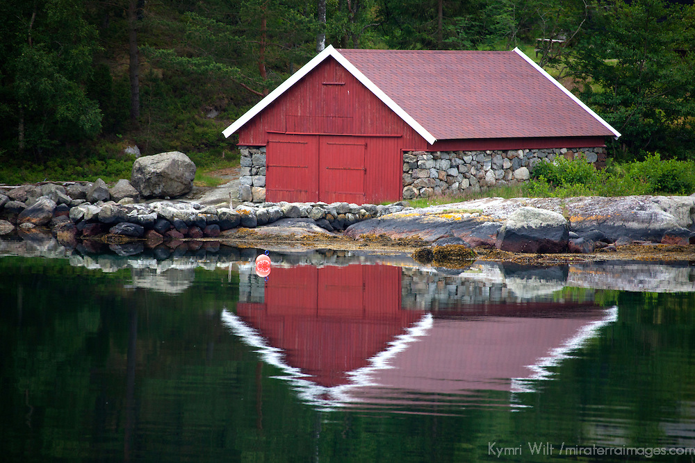 Europe, Norway, Stavanger. Boathouse and reflection on Lysefjord.