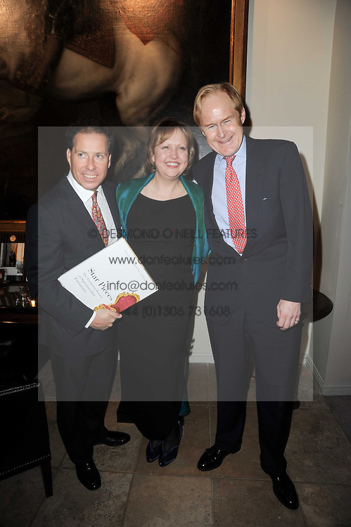Left to right, VISCOUNT LINLEY, HELEN CHISLETT and CHARLES CATOR at the Linley Christmas Party and launch of the book 'Star Pieces' by David Linley, Charles Cator and Helen Chislett held at Linley, 60 Pimlico Road, London on 18th November 2009.