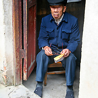 Asia, China, Guangxi, Daxu. A local resident of Daxu ancient village, where the people continue to live tradtionally.