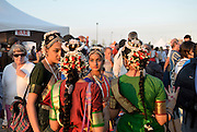 Members of an Indian folk dance group after a performance at the Passport to the World event at the International Chidren`s Games.
