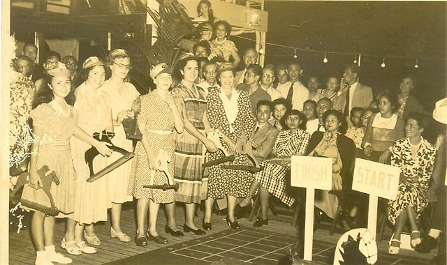 The same trip on boardship travelling to Ceylon. B has a horse as do some other women. At the whistle they had to put their wooden horse on the ground and it was pulled by strings from the other side. It was a race.<br /> <br /> You can see Aimee seated extreme right in a floral dress front row.<br /> <br /> MUM  (Sally)
