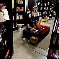 ORLANDO, FL -- January 30, 2008 -- Daniel Mendez of Orlando makes use of the wi-fi signal at the Urban Think bookstore in Thornton Park Central in Orlando, Fla., on Saturday, January 30, 2006.  The independent bookstore serves not only as a place for books, but offers a wine service, beverage bar, multi-media room and a local art displays.