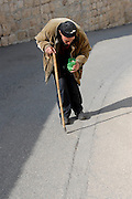 A begger walks up the hill at Mount Olivet in Jerusalem outside the walls of the Old City.