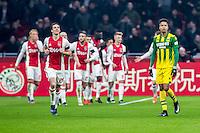 AMSTERDAM - Ajax - ADO , Voetbal , Eredivisie , Seizoen 2016/2017 , Amsterdam ArenA , 29-01-2017 ,  ADO Den Haag speler Tyronne Ebuehi (r) baalt terwijl spelers van Ajax de 2-0 vieren van Ajax speler Lasse Schone