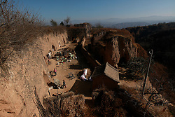 A general view of residents in a 'yaodong' or cave home enclave on the top of a mountain in Yichuan county of Yan'an city, Shaanxi Province China, 06 November 2012. The 'yadong' or cave dwellings are typical in the plateaus of northern China in Shaanxi Province where many of Yan'an's rural population still live in. They are mostly carved out from the yellow earth of the Loess hillsides and are about seven to eight metres deep with height and width of three metres. Former Communist leader Mao Zedong and his comrades are known to have hid in these cave homes during the civil war between the communists and nationalists in 1936 to 1948 as they battle the Kuomintang forces. China's new leaders slated to take over during the 18th National Congress beginning on 08 November are likely to face mounting pressures to tackle the country's rising income inequalities between urban and rural areas that are often the source of simmering resentment and growing unrests on the grassroot level.