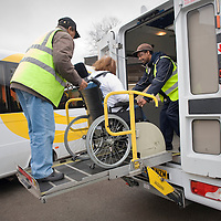 UK. London. Lambeth and Southwark Community Transport. Photo shows HCT (Hackney Community Transport) buses dropping off and collecting people with disabilities at the Lambeth Resource Centre..Photo shows volunteer Norman Grey  helping wheelchair user Rosemary Elliot on to a bus..Photos©Steve Forrest/Workers Photos