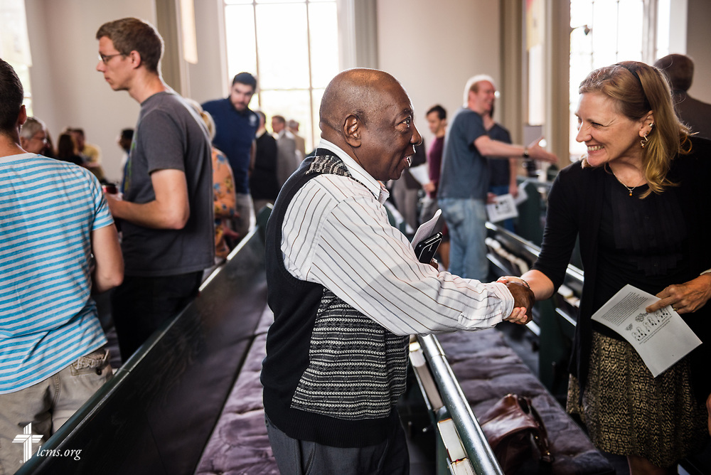 The Rev. Dr. John Loum, director, Ethnic Immigrant Institute of Theology and new career missionary to Africa, greets fellow worshippers following Divine Service at the Chapel of St. Timothy and St. Titus on Wednesday, April 19, 2017, at Concordia Seminary, St. Louis. LCMS Communications/Erik M. Lunsford