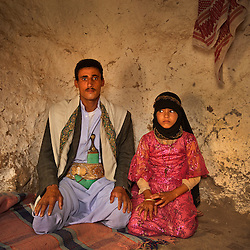 "Majed, 27, and his bride Tahani, 8, are seen in Hajjah, Yemen, July 26, 2010. ""Whenever I saw him, I hid. I hated to see him,"" Tahani recalls of the early days of her marriage."