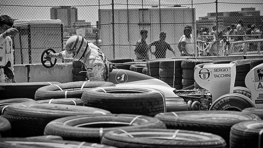 Brazilian Formula One driver Ayrton Senna abandons his Toleman-Hart during practice for the 1984 Detroit Grand Prix. Senna's car lost its brakes on the long front straight during practice and Senna collided with the tire barrier in Tune One. He was unhurt, but during the race, the Toleman sheared off its right rear wheel in the same place, and Senna met the tire wall a second time.<br />