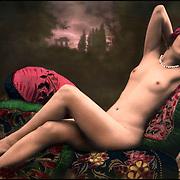 Tinted nude woman, circa 1920. French Realphoto postcard.