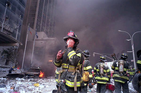 9/11/01, NEW YORK CITY, NEW YORK, UNITED STATES --- Firemen and rescue workers at the scene of the collapsed Twin Towers. --- Photo by Neville Elder/Corbis Sygma