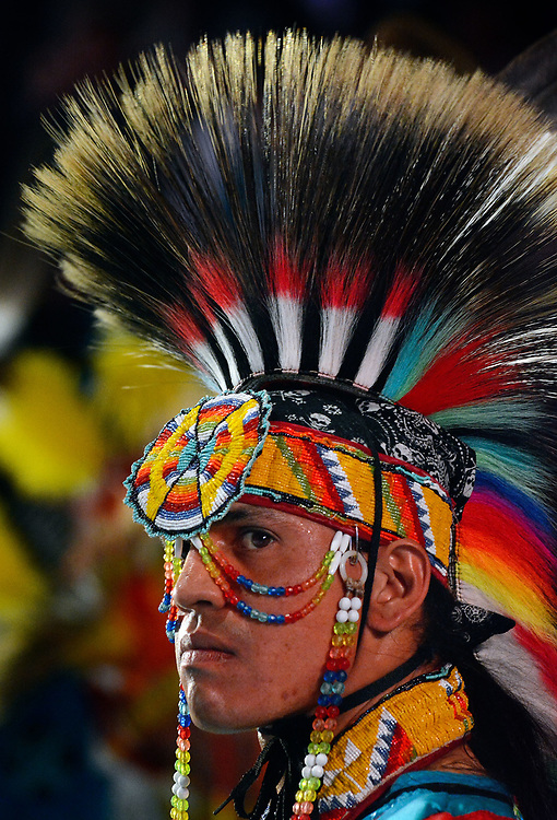 jt042817m/a sec/jim thompson/ This young man looks tot he stage as he takes to the floor for the Grand Entrance at  the 2017 Gathering of Nations Pow-Pow.  Friday April 28, 2017. (Jim Thompson/Albuquerque Journal)