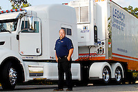 Art Taylor, contractor with Legacy Transportation Services, poses for a photo next to his climate controlled trailer in Milford, Massachusetts on July 11, 2012.  Legacy Transportation's climate controlled trailers are used to transport everything from medical equipment to wine collections.  Photo by Matthew Healey