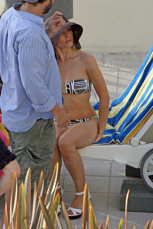 """SANTA MONICA, CALIFORNIA - Wednesday 26th September 2007. NON EXCLUSIVE: Kristen Bell suns herself by the pool while shooting scenes for the latest episode of the hit Tv show """"Heroes"""" . Photograph: Buchan/On location News. Sales: Eric Ford 1/818-613-3955 info@OnLocationNews.com."""