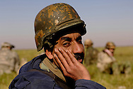 An Iraqi army soldier takes a break after a foot patrol along side U.S. Army Soldiers, Iraq, Jan., 23, 2007.