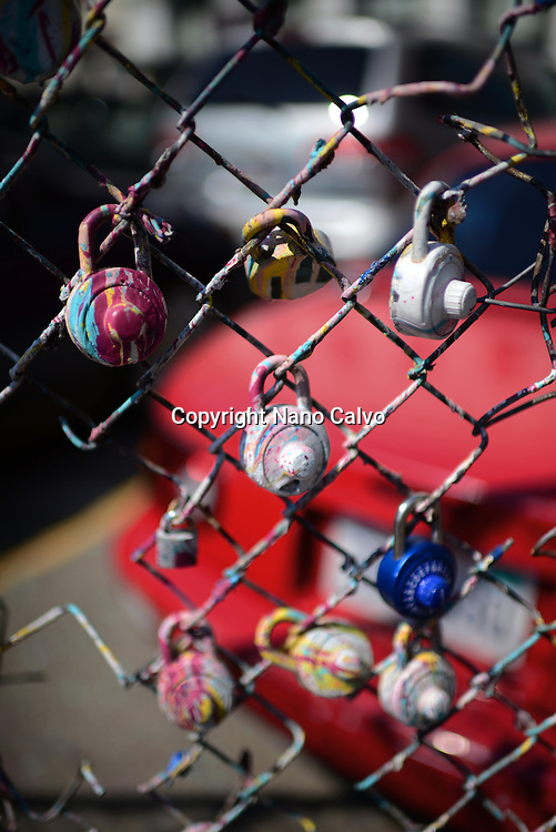 Painted padlocks on parking fence of Market Street, San Francisco