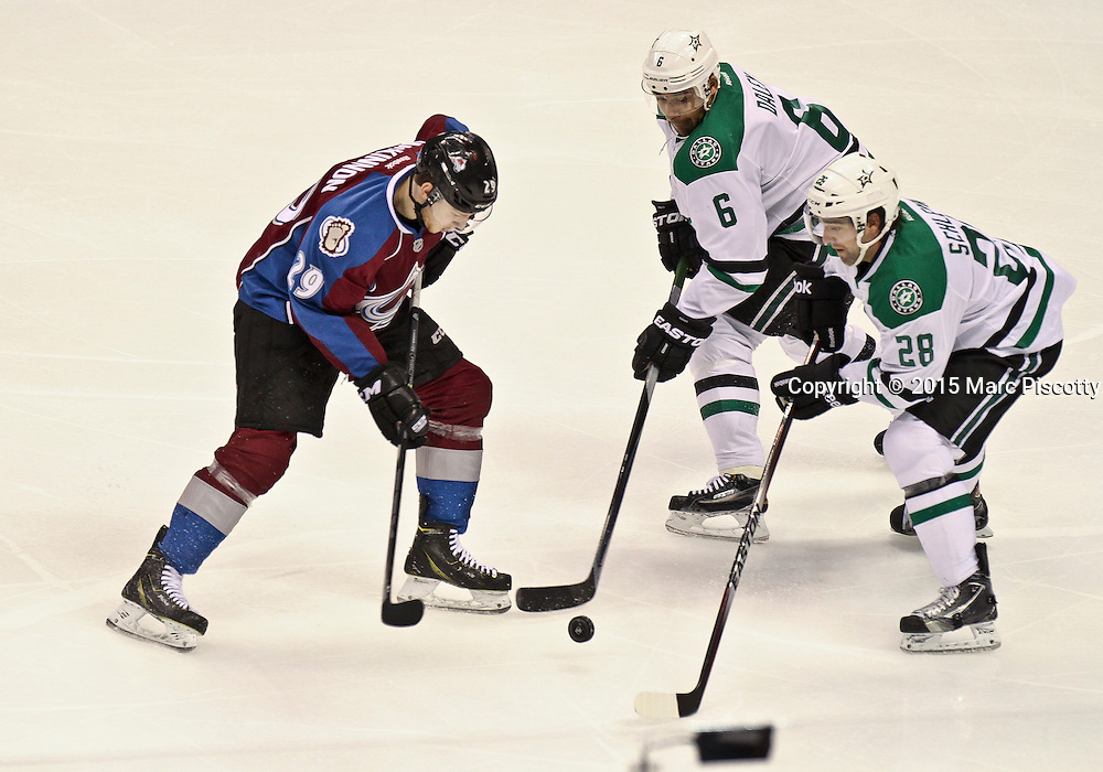 SHOT 1/10/15 2:07:17 PM - The Colorado Avalanche's Nathan MacKinnon #29 tries to split a pair of Dallas Stars defenders including Trevor Daley #6 and David Schlemko #28 during their regular season game at the Pepsi Center in Denver, Co. Colorado won the game 4-3.  (Photo by Marc Piscotty / © 2015)