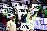 SOUTH BEND, IN - FEBRUARY 11: Notre Dame Fighting Irish fans hold up signs honoring Head coach Muffet McGraw of the Notre Dame Fighting Irish 700th win recently during the game against the Louisville Cardinals at Purcel Pavilion on February 11, 2013 in South Bend, Indiana. Notre Dame defeated Louisville 93-64. (Photo by Michael Hickey/Getty Images)