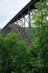 The New River Gorge Bridge over the New River near Fayetteville is among the world's tallest and longest steel arch bridges. With an overall length of 3,030 feet and an arch 1,700 feet long, it was the longest steel arch bridge in the world when it opened in 1977. The bridge remains the longest single-span steel arch bridge in the United States, and it's the third highest bridge in the nation at 876 feet. The New River Gorge Bridge is listed on the National Register of Historic Places.