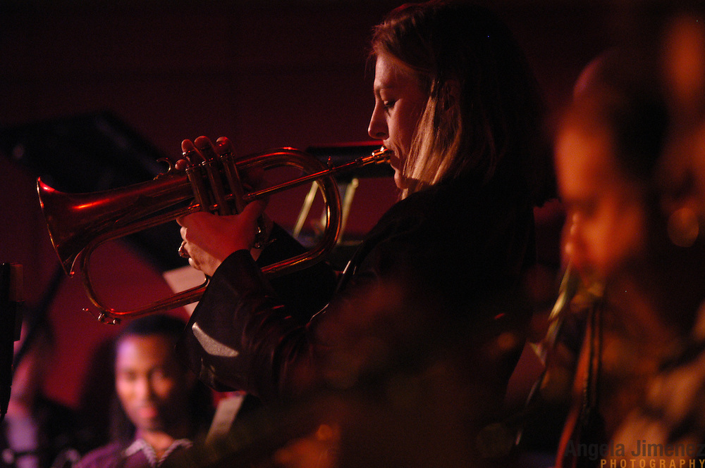 Trumpeter Ingrid Jensen, center, and pianist Frank Kimbrough, left, perform with The Maria Schneider Jazz Orchestra at the Jazz Standard in New York City on March 24, 2005.