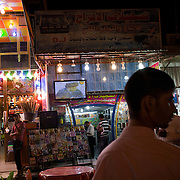 Iraqi Shiites watch videos of firebrand Shi'a cleric Moqtada al-Sadr on a video store television outside the Khadamiyah Shrine September 04, 2010 in Baghdad, Iraq. An intense power struggle between Iraq's Shia political leaders and parties is one of the main obstacles to the formation of a new government since the inconclusive March 2010 poll, according to senior Iraqi officials involved in ongoing negotiations. Credit: Scott Nelson for the Wall Street Journal.Slug: Iraq - Shia divisions.