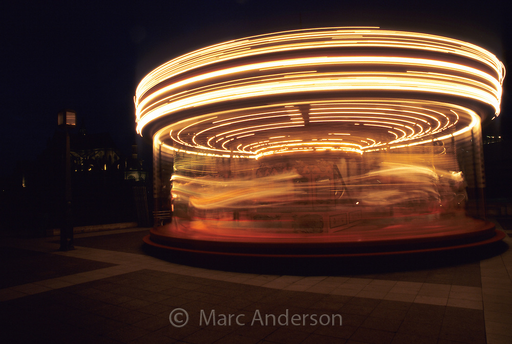 A spinning carousel at night, Paris, France.