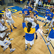 Delaware Forward Elena Delle Donne (11) (Right) high fives her teammate Delaware Forward Danielle Parker (12) during player introductions prior the start of a Colonial Athletic Association conference Basketball Game against Northeastern Sunday, Feb. 26, 2012, at the Bob Carpenter Center in Newark, Del.