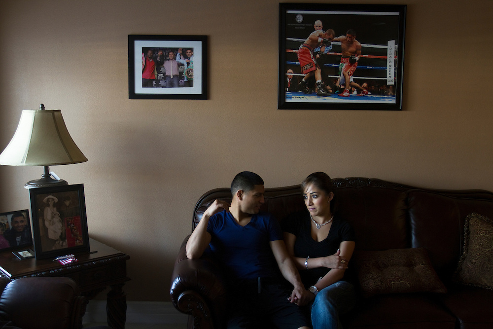 Bantam weight world champion boxer Abner Mares at home with his wife, Nathalie and daughters Emily, 5, and Amber.