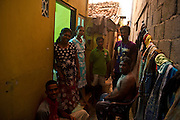 A family gathering outside a home off Ratnam Road. At dusk, people come out of their homes to enjoy the evening air.