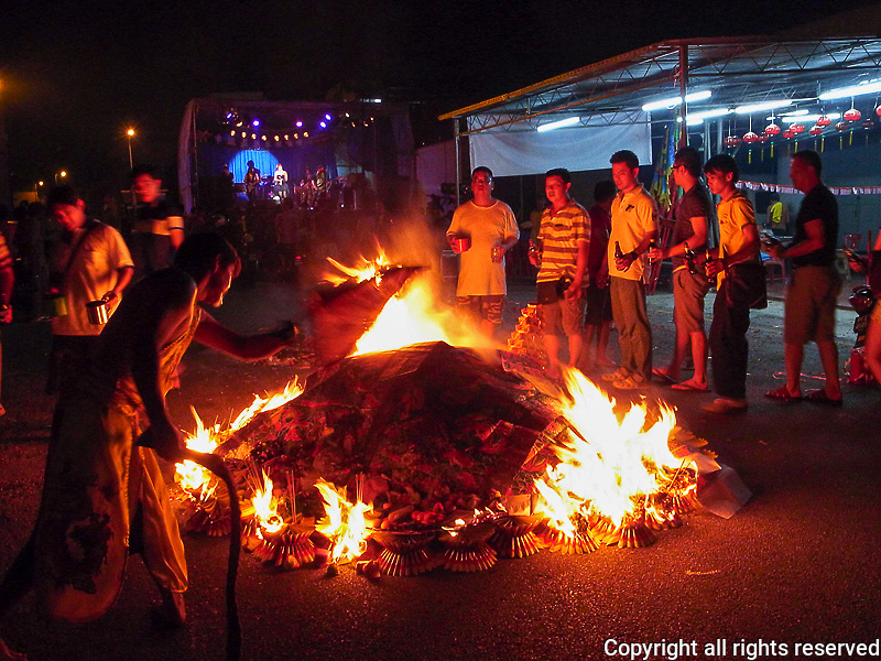burning paper money as an offering for Hungry Ghost festival, Armenian Street and Weld Quay