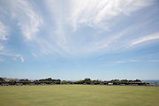 Bowling greens give a sparse and minimalist landscape on the Coogee to Bondi beach Coastal walk , Sydney