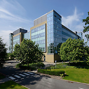 A modern corporate office building on a Cheshire business park