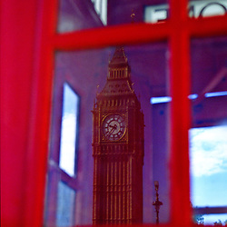Telephone booth reflecting Big Ben, London, England