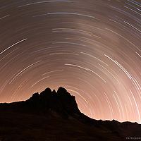 A two hour exposure facing directly north at night started about 25 minutes after sunset creating swirling circle of stars as the earth spins, while just enough light lit up a side of the ragged mountains in the Cordillera huayhuash in the Andeas Mountains of Peru.
