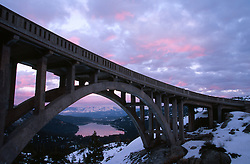 &quot;Sunset at Rainbow Bridge&quot;- Rainbow Bridge is located up Old Hwy 40, west of Donner Lake. Donner Lake and Truckee, CA can be seen in the distance.<br />